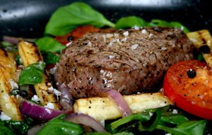 Summer lunch with spring vegetables, cherry tomato & steak, macro closeup