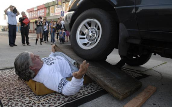 "Stanley ""Stanless Steel"" Pleskun under a car tyre."